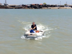 Here is Daryl returning to the boat with the dinghy laden with containers of diesel!