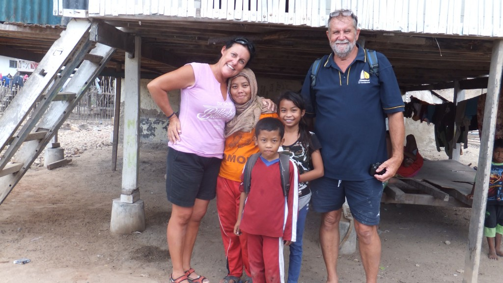 """The family of """"Vidhel Castro"""", Daryl and I look like giants next to his lovely wife!"""