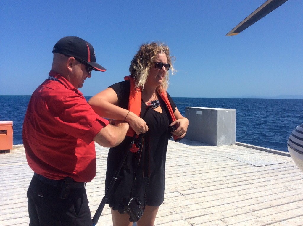 "Casey helps her with the lifejacket as she informs him she has her own set of ""buoyancy aids"""