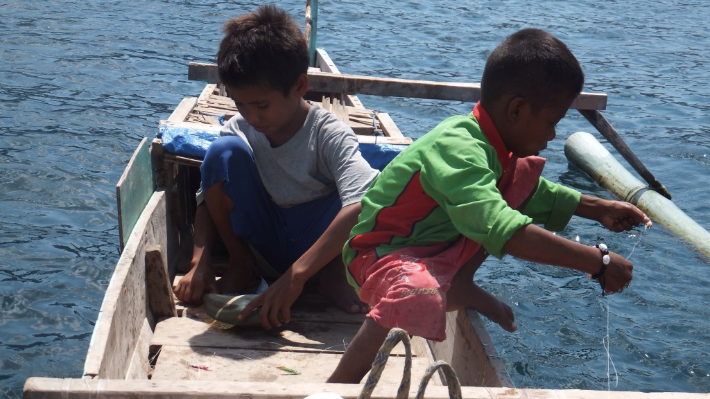 These two boys rowed over to us in their little wooden boat, one was 12 (looked about 8), his brother was 7 (looked about 5) Young looking, with an ability to fish - they seemed pleased when we purchased their catch for our dinner!